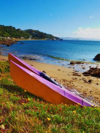 Kayak on the beach - Karaka Bay, New Zealand photo