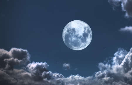 over the moon: A  photo of moon and clouds Stock Photo