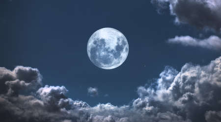 A  photo of moon and clouds Stock Photo