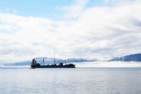 A photo of a large cargo ship by the coast of New Zealand photo