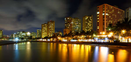 A nigh photo of Waikiki hotels and beach skylines photo