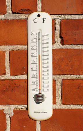 extreme weather: A photo an outdoor thermometer on brick wall