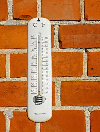 hotness: A photo an outdoor thermometer Stock Photo