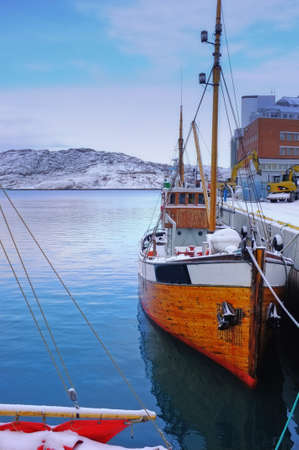 A photo of small Norwegian harbor North of the Polar Circle, Bodoe. Wintertime light. photo