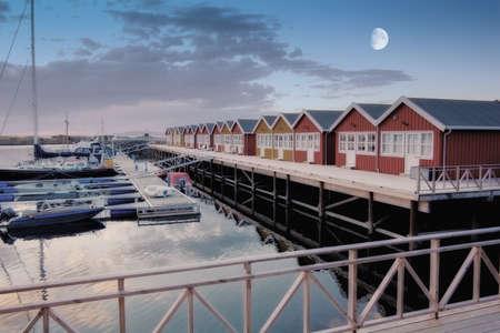 a photo of Harbor houses in Kjerringoy, Norway photo