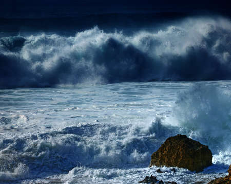 A photo of Huge waves at night