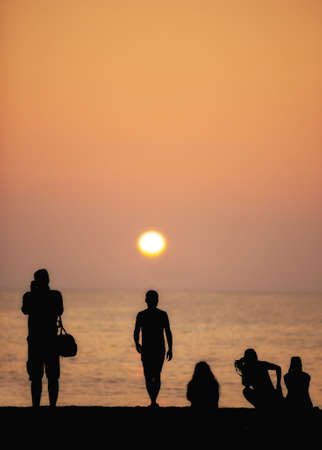 A photo of people watching the sunset photo