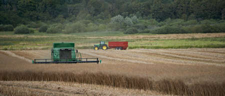 A photo of a harvester and countryside photo