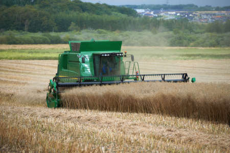 A photo of a harvester and countryside Stock Photo - 14861001