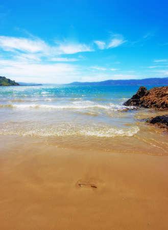 new zealand beach: A photo of Karaka Bay - New Zealand Stock Photo