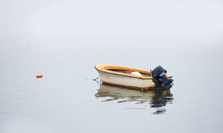 shallop: A photo of Small boat an early foggy morning