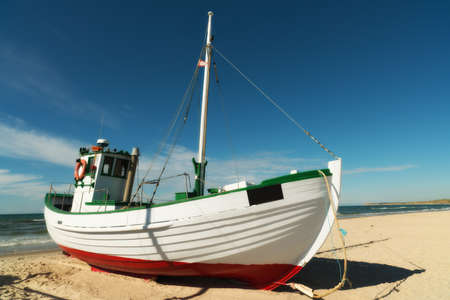 bow of boat: A photo of Fishing boat on the beach, Jutland, Denmark