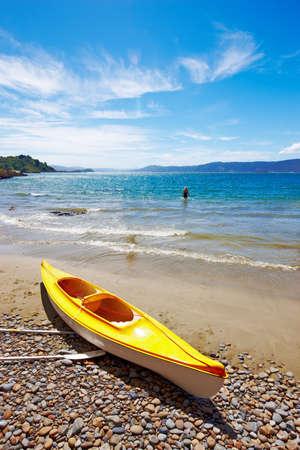 new zealand beach: A Kayak on the beach - New Zealand, Karaka Bay,