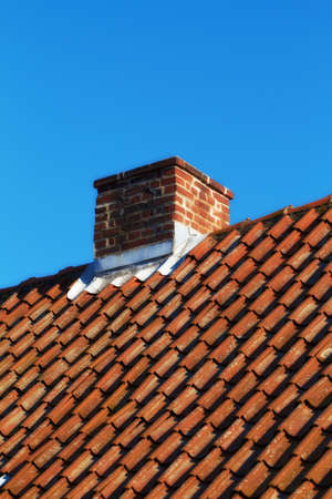 Chimney on a roof of an old residential house photo