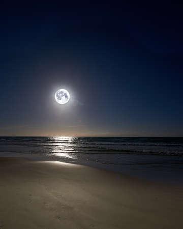 A night photo of moon, beach and ocean, Denmark photo