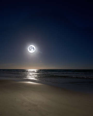 A night photo of moon, beach and ocean, Denmark