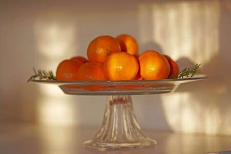 An image of a oranges and glass photo