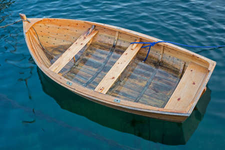 insular: A photo of a rowBoat on the serene water Stock Photo