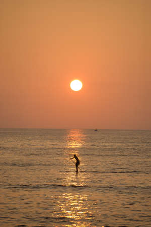 A photo of sunset surfer in Waikiki, Honolulu, Hawaii photo