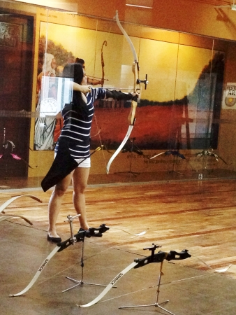 recurve: Girl archer in an archery range Stock Photo