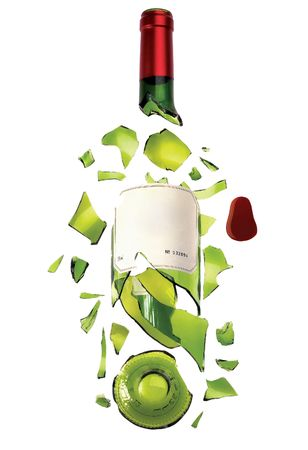 Broken bottle. A shattered bottle of wine isolated on a white background.