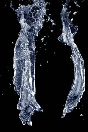 against the flow: Water flow effect.Water splashing up isolated against a black background. Stock Photo
