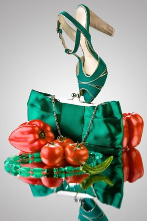 haversack: Green shoe and handbag. Green shoe, handbag and accessories with red peppers and tomatoes.