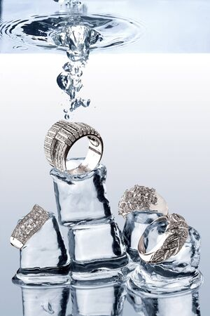 dropped: Underwater Jewelery. A view of jewelery being dropped on ice cubes underwater. Stock Photo