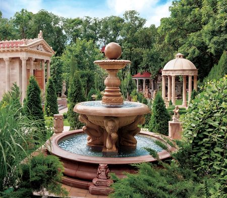 woodland sculpture: Water fountain in old park. Scenic view of decorative water fountain and structures in old park, Gelendzhik, Krasnodar Krai, Russia. Stock Photo