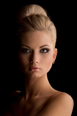 bombshell: Portrait of gorgeous woman. Portrait of gorgeous blond woman against black background Stock Photo