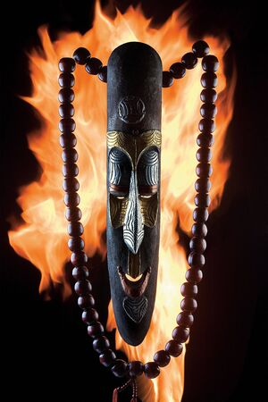 spirited: Mask on Fire. An illustrated background of an African mask on fire.
