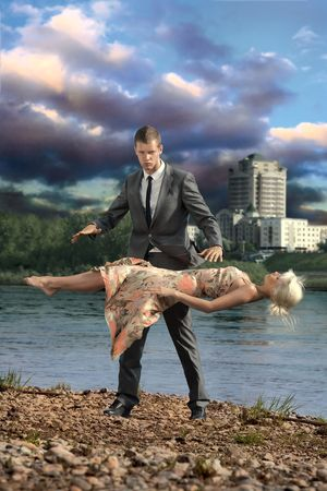 Illusionist and woman. Illusionist suspending young woman in midair.  photo