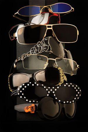 Trendy Sunglasses. Trendy sunglasses arrangement on a black studio background. photo