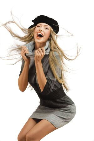 Happy Fashion Model. A happy fashion model in an energetic pose, isolated on a white background. photo