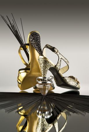 Gold and silver shoes. Glamorous gold and silver high heel pumps. Stock Photo - 4490246