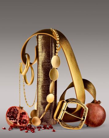 Belt & Fruits. A background of an abstract artistic image of a golden belt with pomegranates. photo