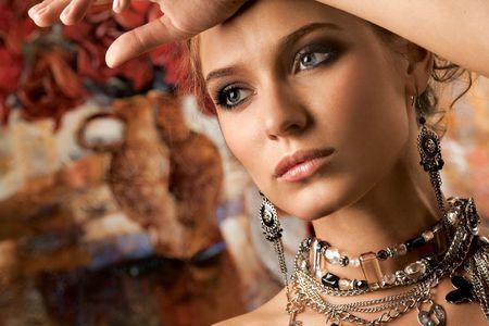 fashion jewellery: Glamorous Woman. A portrait of a glamorous woman wearing beautiful jewelery.
