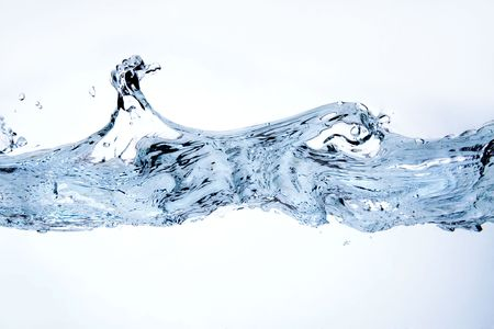 Splashing water on white. Close up of water splashing on surface, isolated on white background. photo
