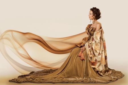 gown: Woman sitting in a formal full flowing gown