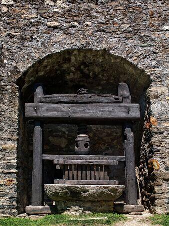 Wine Press. Old wooden wine press in the Caste of Montebello. Swiss town in Bellinzona. photo