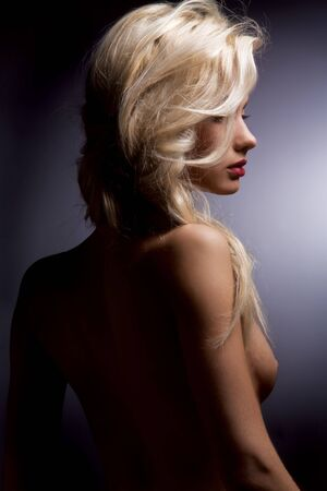 nude female figure: Portrait of nude woman with blonde hair.
