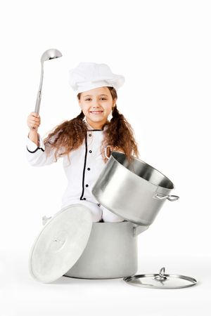 cheerfully: A girl dressed as a cooking chef, playing with large pots and pans.