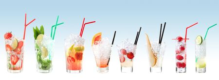 fruity: Row of colorful fruity mojito cocktails in a variety of glasses with straws.