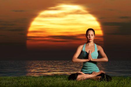 Yogi sunrise. A sportive beautiful woman training yoga on the beach at dawn. Stock Photo - 8093471