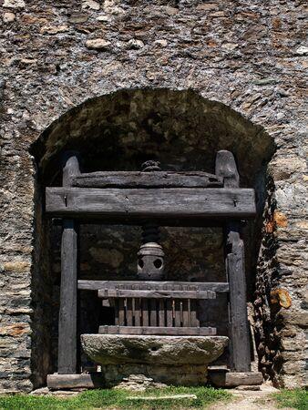 winemaking: Winemaking secrets. Ancient wooden wine press in Montebello Castle, Switzerland.