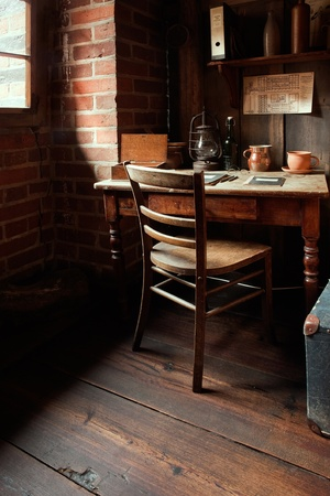 A cozy miller. A cozy millers room corner with wooden furniture and brickwalls in Malbork, Poland. photo
