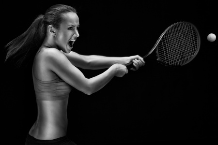 recreational sport: Female tennis player with racket ready to hit a tennis ball. Stock Photo