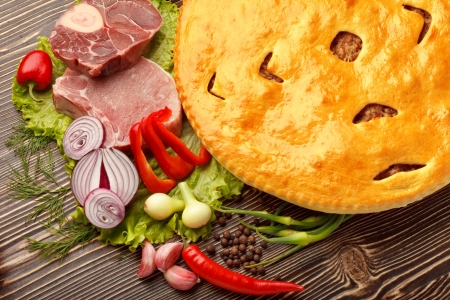 meat pie: Ossetian cuisine  Fydzhin meat pie and vegetables on wood  Stock Photo