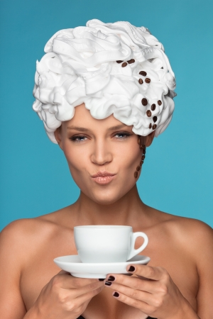 sexy food: A young lady in a whipped cream on her head with a coffee cup