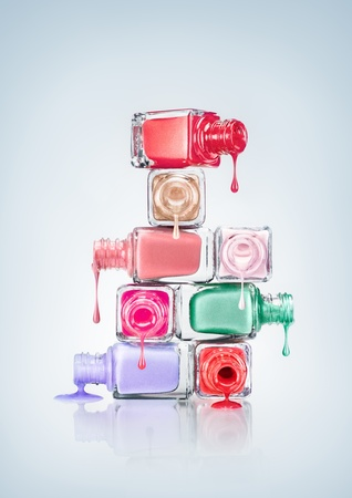 manicure and pedicure: Nail polish dripping from stacked bottles